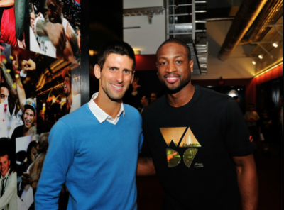 World number one Novak Djokovic met up with Dwyane Wade of the Miami Heat after the NBA reigning champions posted their 26th consecutive victory over the Charlotte Bobcats